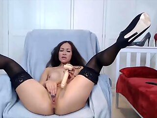 Asian mistress in heels and stockings bangs pussy