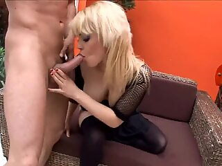 Busty blonde milf has sex in thigh high stockings