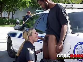 One big black dong VS two horny milf mouths, in a hidden place in the street, crazy female cops