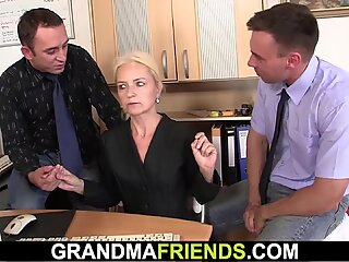 Old blonde woman sucks two cocks for job