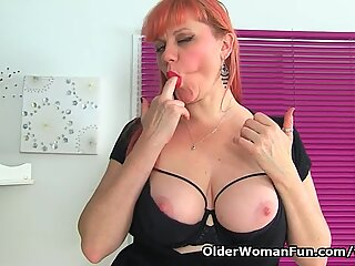 English milf Velvetina rips her tights and plays