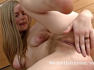 Hairy girl Evelina turns up the heat in kitchen