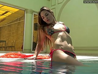 Sexy Nicole Pearl with small tits in the pool