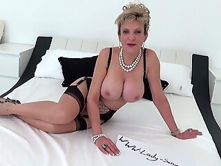 MILF Lady Sonia drops to her knees and sucks a huge cock