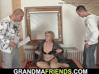 skinny blonde mature lady spreads gams for two guys