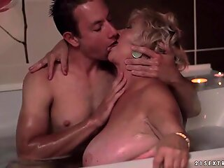 Fat granny and young man making hot romantic love