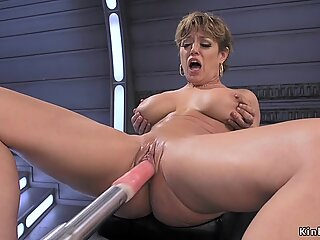 Busty Milf fucks anal machine and squirts