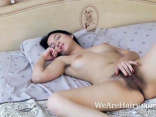 Bellavitana disrobes and strokes in her bedroom