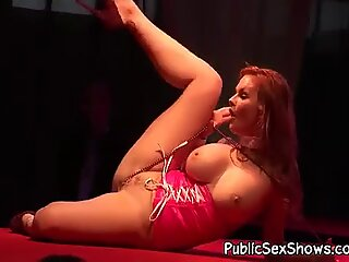 Busty redhead inserts a toy in her cunt