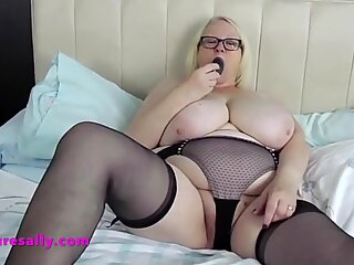 Granny's panties hardly contain her big pussy