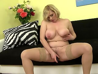 Lovely busty mature mom feeding her pussy